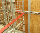 Strapping Tesco Cages